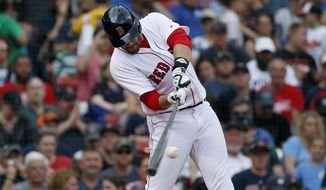 Boston Red Sox's J.D. Martinez hits a two-run home run during the fifth inning of a baseball game against the Baltimore Orioles in Boston, Sunday, May 20, 2018. (AP Photo/Michael Dwyer)