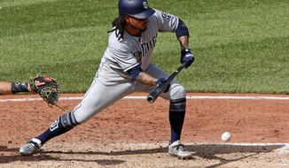 San Diego Padres' Freddy Galvis drives in a run with a bunt-single off Pittsburgh Pirates relief pitcher Felipe Vazquez in the ninth inning of a baseball game in Pittsburgh, Sunday, May 20, 2018. (AP Photo/Gene J. Puskar)
