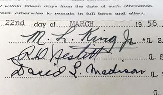 This photo shows the signature of the Rev. Martin Luther King Jr. on a court document in the archive of Alabama State University in Montgomery, Ala. The school is preserving and digitizing historic court documents linked to the civil rights movement that were found in a box at the county courthouse. (Alabama State University via AP)