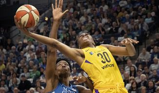 Sylvia Fowles, left, of the Minnesota Lynx defends Nneka Ogwumike, right, of the Los Angeles Sparks in the second quarter  of a WNBA basketball game Sunday, May 20, 2018, Minneapolis, Minn.  (Carlos Gonzalez /Star Tribune via AP)