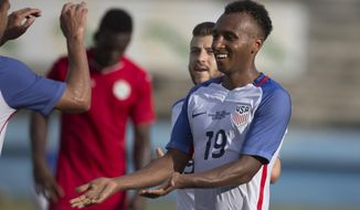 FILE - In this Oct. 7, 2016, file photo, Julian Green, of the U.S., celebrates scoring the second and final goal against Cuba during a friendly soccer match in the Pedro Marrero Stadium in Havana, Cuba. Green returns to the U.S. national team for the first time in two years, joining star midfielder Christian Pulisic on a young American roster for a May 28, 2018, exhibition against Bolivia at Chester, Pa. (AP Photo/Desmond Boylan, File)