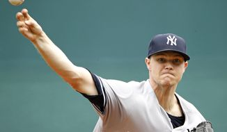 New York Yankees starting pitcher Sonny Gray throws during the first inning of a baseball game against the Kansas City Royals, Sunday, May 20, 2018, in Kansas City, Mo. (AP Photo/Charlie Riedel)