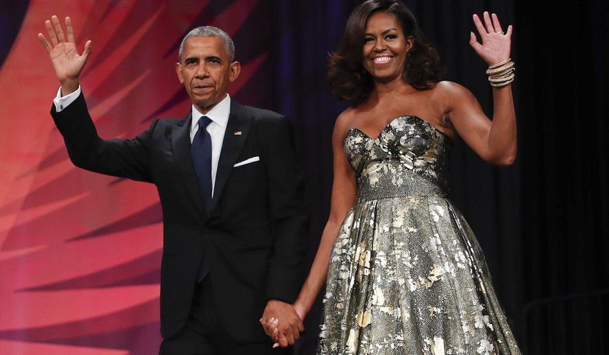 Former President Barack Obama and first lady Michelle Obama just signed a new contract to produce new programming for Netflix. (Associated Press)