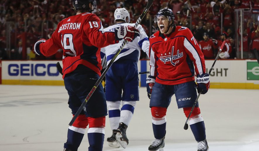 Washington Capitals right wing T.J. Oshie (77) celebrates his goal against the Tampa Bay Lightning with teammate Washington Capitals center Nicklas Backstrom (19), from Sweden, during the second period of Game 6 of the NHL Eastern Conference finals hockey playoff series, Monday, May 21, 2018, in Washington. Skating away is Tampa Bay Lightning left wing Alex Killorn (17). (AP Photo/Pablo Martinez Monsivais) ** FILE **