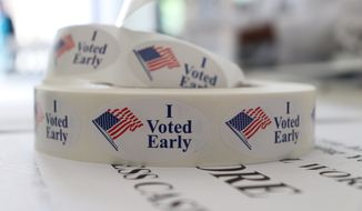A roll of stickers awaiting distribution to early voters sits on a table at the check-in station at the Pulaski County Courthouse Annex in Little Rock, Ark., on Monday, May 21, 2018. (AP Photo/Kelly P. Kissel) ** FILE **