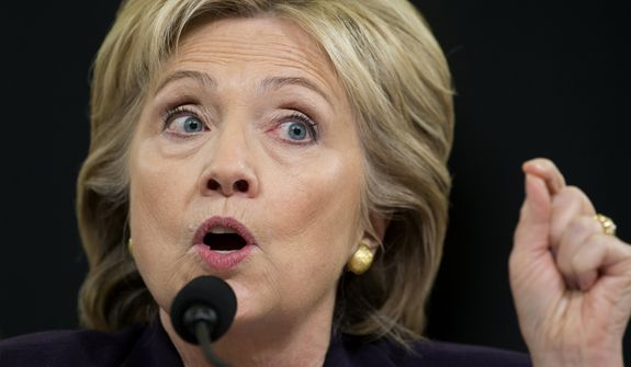 In this Oct. 22, 2015, file photo, then-Democratic presidential candidate, former Secretary of State Hillary Clinton testifies on Capitol Hill in Washington, before the House Benghazi Committee. (AP Photo/Carolyn Kaster, File)