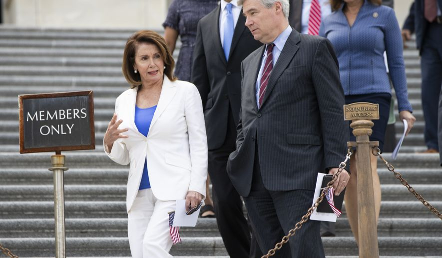"House Minority Leader Nancy Pelosi, D-Calif., left, speaks with Sen. Sheldon Whitehouse, D-R.I., as congressional Democrats gather on the steps of the Capitol to promote their ""Better Way"" agenda, in Washington, Monday, May 21, 2018. (AP Photo/J. Scott Applewhite)"