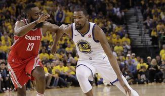Golden State Warriors forward Kevin Durant (35) dribbles against Houston Rockets guard James Harden (13) during Game 3 of the NBA basketball Western Conference Finals in Oakland, Calif., Sunday, May 20, 2018. (AP Photo/Marcio Jose Sanchez) **FILE**