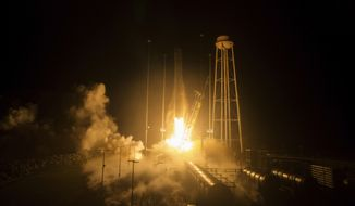 The Orbital ATK Antares rocket, with the Cygnus spacecraft onboard launches Monday, May 21, 2018, at NASA's Wallops Flight Facility in Virginia. The Orbital ATK launched a fresh load of supplies to the International Space Station. (Aubrey Gemignani/NASA via AP)