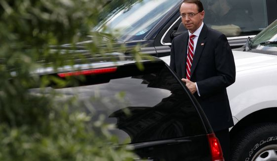 Deputy Attorney General Rod Rosenstein leaves a meeting at the White House, Monday, May 21, 2018, in Washington. (AP Photo/Evan Vucci)