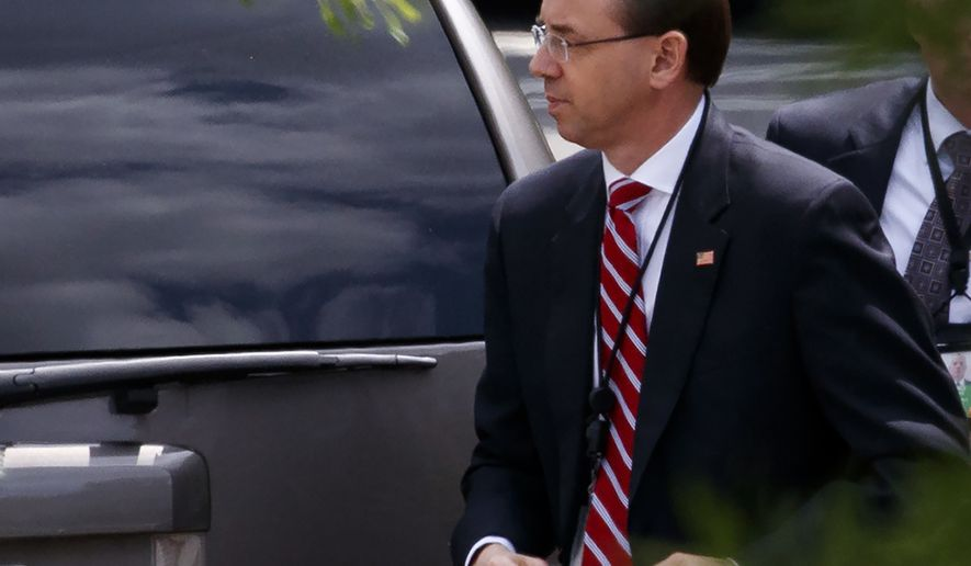 Deputy Attorney General Rod Rosenstein arrives for a meeting at the White House, Monday, May 21, 2018, in Washington. (AP Photo/Evan Vucci)