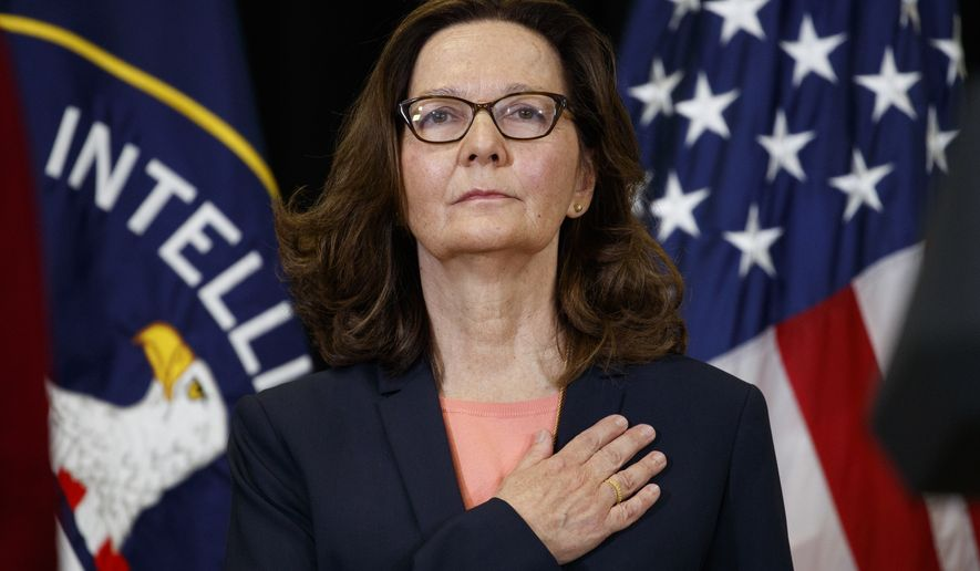Incoming Central Intelligence Agency director Gina Haspel stands for the national anthem during her swearing-in ceremony at CIA Headquarters, Monday, May 21, 2018, in Langley, Va. (AP Photo/Evan Vucci)