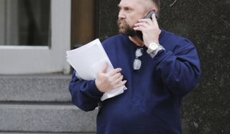 FILE - In this Feb. 2, 2016, file photo, Arthur Rathburn of Grosse Pointe Park, Mich., walks out of Theodore Levin United States Courthouse in Detroit. Prosecutors are seeking a 14-year prison sentence for Rathburn convicted of dealing diseased body parts for medical training. He is returning to Detroit federal court on Monday, May 21, 2018, four months after he was convicted of fraud and shipping hazardous material. (Regina H. Boone/Detroit Free Press via AP)