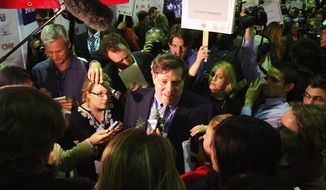 "Mark Penn, a supporter of the Clinton campaign, as he responds to questions in the ""Spin Room"" following the debate between Democratic presidential hopefuls Sen. Hillary Clinton, D-N.Y. and Sen. Barack Obama, D-Ill., on the University of Texas-Austin campus, in this, Feb. 21, 2008 file photo. Penn, the pollster and senior strategist for Hillary Rodham Clinton's presidential bid, left the campaign Sunday April 6, 2008, after it was disclosed he met with representatives of the Colombian government to help promote a free trade agreement Clinton opposes.  (AP Photo/Austin American-Statesman, Larry Kolvoord, file)"