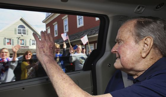 In this Sunday, May 20, 2018, photo provided by the office of former President George H.W. Bush, the former president waves to supporters as his motorcade arrives in Kennebunkport, Maine. A Bush spokesman said the nation's 41st president was eager to get to Maine after enduring his wife's death and then falling ill with a blood infection that landed him in the hospital. (Evan Sisley via AP)