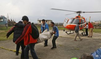 The body of a Macedonian 63-year-old Gjeorgi Petkov is unloaded from a helicopter at Teaching Hospital in Kathmandu, Nepal, Monday, May 21, 2018. Two foreign climbers, including Petkov, attempting to scale Mount Everest have died on the world's highest peak, a Nepal mountaineering official said Monday. (AP Photo/Niranjan Shrestha) **FILE**