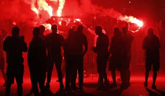 Fans of Warsaw's soccer team Legia Warszawa burn flares as they celebrate their club's victory of the Polish soccer championship in Warsaw, Poland, Sunday, May 20, 2018. (AP Photo/Czarek Sokolowski)