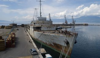 In this Thursday, May 10, 2018 aerial photo, Galeb (Seagull), the yacht once used by the late president of socialist Yugoslavia Josip Broz Tito, is moored in the port of the Adriatic city of Rijeka, Croatia. Decades of rust are covering its hull, the furniture is broken in its once luxurious salons, its powerful engines are permanently idle _ but against all odds, the iconic yacht that once belonged to the late Yugoslav strongman has been given a new lease of life and will be turned into a floating museum. (AP Photo/Darko Bandic)
