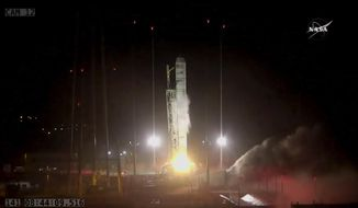 In this photo made from NASA video, the Orbital/ATK Cygnus CRS-9 sits on top of an Antares rocket as it launches from NASA's Wallops Flight Facility, Monday morning, May 21, 2018, in Virginia. (NASA via AP)