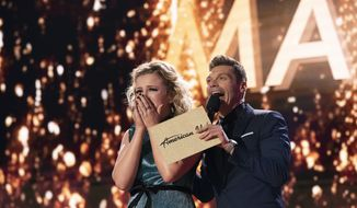 In this May 21, 2018 photo provided by ABC, Maddie Poppe, left, reacts with Ryan Seacrest after being announced the winner of American Idol in Los Angeles. The singer-songwriter bested Caleb Lee Hutchinson and Gabby Barrett in the two-hour finale on ABC. (Mitch Haaseth/ABC via AP)