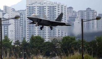 In this May 16, 2018, file photo, a U.S. F-22 Raptor stealth fighter jet lands as South Korea and the United States conduct the Max Thunder joint military exercise at an air base in Gwangju, South Korea. North Korean media are stepping up their rhetorical attacks on South Korea and joint military exercises with the United States, warning that a budding detente could be in danger. State media unleashed three strongly worded commentaries Tuesday, May 22, 2018, slamming Seoul and Washington for the maneuvers and demanding Seoul take action against defectors it claimed were sending anti-North Korea propaganda leaflets across the border.  (Park Chul-hog/Yonhap via AP)