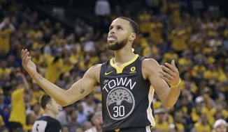 Golden State Warriors guard Stephen Curry (30) reacts during the first half of Game 4 of the NBA basketball Western Conference Finals between the Warriors and the Houston Rockets in Oakland, Calif., Tuesday, May 22, 2018. (AP Photo/Marcio Jose Sanchez) **FILE**