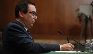 Treasury Secretary Steve Mnuchin takes down some notes while testifying before the Senate Appropriations Financial Services and Government Subcommittee hearing on Capitol Hill in Washington, Tuesday, May 22, 2018. (AP Photo/Pablo Martinez Monsivais)