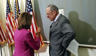 Sen. Chuck Schumer, D-NY., right, and House Minority Leader Nancy Pelosi of Calif., left, talk to one another after hosting a news conference to announce a proposed increase to teacher pay, on Capitol Hill in Washington, Tuesday, May 22, 2018. (AP Photo/Pablo Martinez Monsivais)