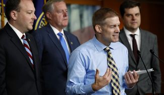 Rep. Jim Jordan, R-Ohio, speaks next to Rep. Lee Zeldin, R-N.Y., left, Rep. Mark Meadows, R-North Carolina, and Rep. Matt Gaetz, R-Fla., during a news conference with House members, where they called for a second prosecutor to investigate the Dept. of Justice and FBI, Tuesday, May 22, 2018, on Capitol Hill in Washington. (AP Photo/Jacquelyn Martin)