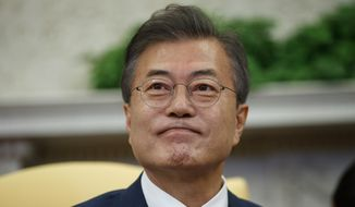 South Korean President Moon Jae-In listens during a meeting with President Donald Trump in the Oval Office of the White House, Tuesday, May 22, 2018, in Washington. (AP Photo/Evan Vucci)