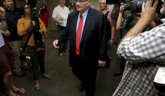 Former Arizona Sheriff Joe Arpaio arrives Tuesday, May 22, 2018 at the Arizona Secretary of State's office in Phoenix to turn in petition signatures in his bid to appear on the ballot in the race to succeed retiring U.S. Sen. Jeff Flake. The Republican lawman's campaign says it turned in 10,000 signatures on Tuesday so he can compete in the GOP primary on Aug. 28th. (AP Photo/Matt York)