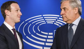 European Parliament President Antonio Tajani, right, welcomes Facebook CEO Mark Zuckerberg upon his arrival at the EU Parliament in Brussels on Tuesday, May 22, 2018. European Parliament President Antonio Tajani, right, welcomes Facebook CEO Mark Zuckerberg upon his arrival at the EU Parliament in Brussels, Tuesday, May 22, 2018.  European Union lawmakers plan to press Zuckerberg on Tuesday about data protection standards at the internet giant at a hearing focused on a scandal over the alleged misuse of the personal information of millions of people. (AP Photo/Geert Vanden Wijngaert)