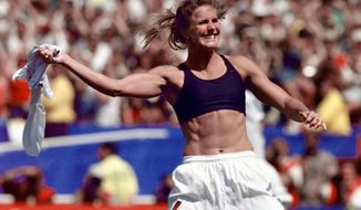 In this July 10, 1999, file photo, the United States' Brandi Chastain celebrates by taking off her jersey after kicking in the game-winning goal in a penalty shootout against China in the FIFA Women's World Cup Final at the Rose Bowl in Pasadena, Calif. ; (AP Photo/Mark J. Terrill, File)