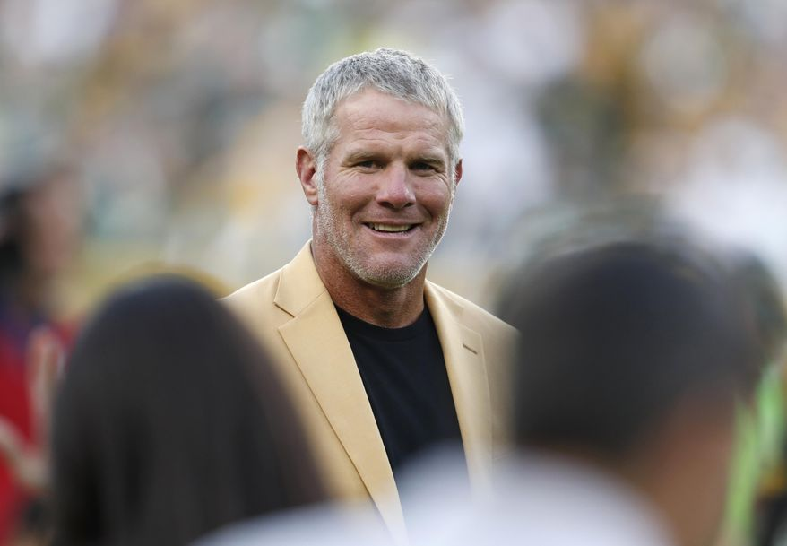 In this Oct. 16, 2016, file photo, Hall of Fame quarterback Brett Favre is shown during a halftime ceremony of an NFL football game against the Dallas Cowboys, in Green Bay, Wis. (AP Photo/Matt Ludtke, File)
