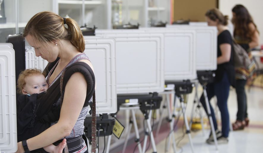 Voters cast their ballots at Clarke Central High School in Athens, Ga., Tuesday, May 22, 2018. (Joshua L. Jones/Athens Banner-Herald via AP)