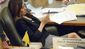 FILE - In this March 20, 2015, file photo, state Rep. Monica Youngblood, R-Albuquerque, waits for more bills to be debated on the House floor in Santa Fe, N.M. Youngblood insists in video released by police that she hasn't consumed alcohol, but the officer who stops her says he can smell it. Police on Tuesday, May 22, 2018, released lapel video of the arrest of Youngblood on aggravated drunken driving charge. She was detained early Sunday at a DWI checkpoint. In the video, Youngblood complies with the officer's requests to balance on one leg and count forward and backward. She declined a breathalyzer test. (AP Photo/Russell Contreras, File)
