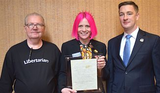Original Libertarian Party  co-founder D. Frank Robinson of Oklahoma, representative and historical preservation committee chair Caryn Ann Harlos, and Libertarian National Committee Chair Nicholas Sarwark display the newly discovered original Statement of Principles for the Party. (Libertarian Party)