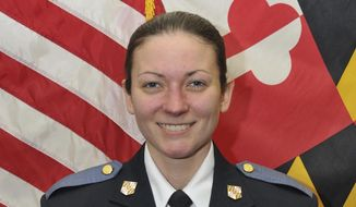This undated photo made available by the Baltimore County Police and Fire Department Tuesday, May 22, 2018, shows Baltimore County Police officer first class Amy Caprio, who was killed in the line of duty on Monday, May 21, 2018. A 16-year-old boy has been charged with first-degree murder in the slaying of a Caprio, and three other suspects were taken into custody, authorities said Tuesday, May 22, 2018.  (Baltimore County Police and Fire Department via AP)