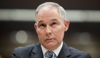 In this May 16, 2018 photo, Environmental Protection Agency Administrator Scott Pruitt appears before a Senate Appropriations subcommittee on the Interior, Environment, and Related Agencies on budget on Capitol Hill in Washington. The Environmental Protection Agency reversed course Tuesday and allowed a reporter for The Associated Press to cover a meeting on water contaminants after she was earlier barred and shoved out of the building by a security guard. (AP Photo/Andrew Harnik)