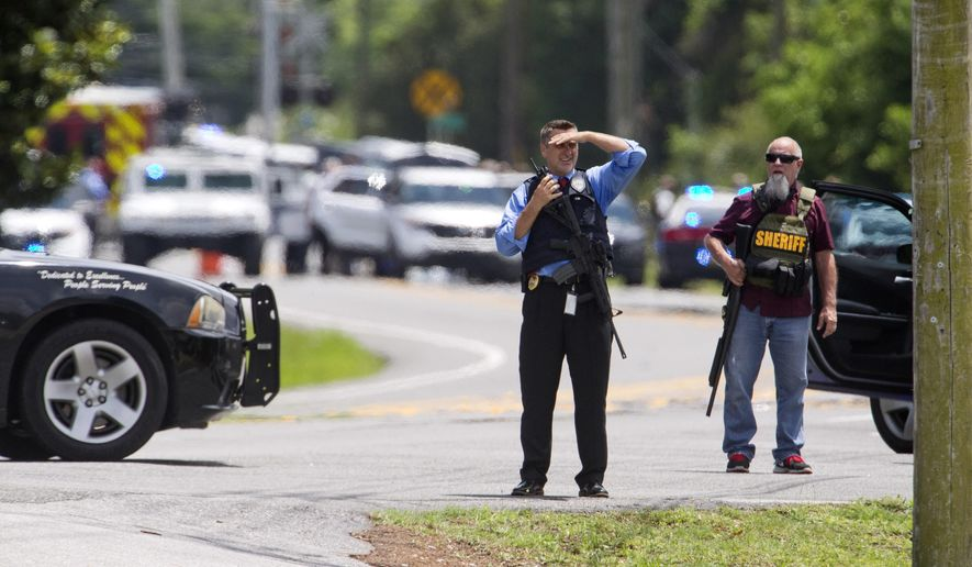 Bay County Sheriff's Office and other law enforcement respond to an active shooter at the corner of 23rd Street and Beck Avenue, Tuesday, May 22, 2018, in Panama City, Fla. (Joshua Boucher/News Herald via AP)