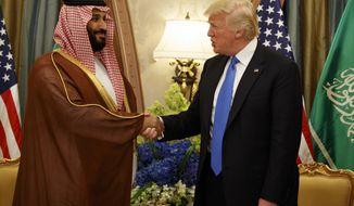 FILE - In this May 20, 2017, file photo, President Donald Trump shakes hands with Saudi Deputy Crown Prince and Defense Minister Mohammed bin Salman in Riyadh. In emails obtained by The Associated Press, George Nader claims he later met with Mohammed bin Salman, who by then had been elevated to crown prince, and Abu Dhabi's crown prince, Sheikh Mohammed bin Zayed Al Nahyan, in a lobbying effort to alter U.S. policy in the Middle East. (AP Photo/Evan Vucci, File)