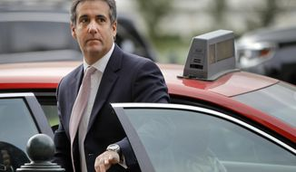 FILE - In this Sept. 19, 2017, file photo, Michael Cohen, President Donald Trump's personal attorney, steps out of a cab during his arrival on Capitol Hill in Washington. Cohen's longtime business partner Evgeny Freidman pleaded guilty, Tuesday, May 22, 2018, to tax fraud in a deal that requires him to cooperate in any ongoing investigations. (AP Photo/Pablo Martinez Monsivais)