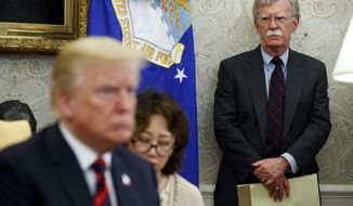 President Donald Trump meets with South Korean President Moon Jae-In in the Oval Office of the White House, Tuesday, May 22, 2018, in Washington, as National Security Adviser John Bolton watches. (AP Photo/Evan Vucci) ** FILE **