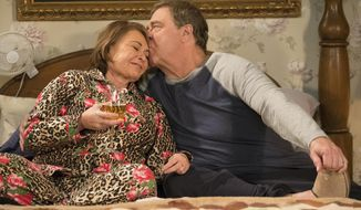 "In this image released by ABC, Roseanne Barr, left, and John Goodman appear in a scene from the season finale of ""Roseanne,"" airing Tuesday, May 22. (Adam Rose/ABC via AP)"