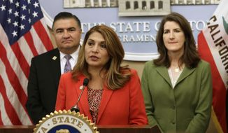 Assemblywoman Sharon Quirk-Silva-D-Fullerton, center, discusses her proposed state constitutional amendment that would curb the University of California's autonomy during a news conference, Tuesday, May 22, 2018, in Sacramento, Calif. The amendment would limit salaries and shorten terms for regents from 12 years to four and strip the president's voting power on the Board of Regents. The proposal requires a two-thirds vote of the Legislature and voter approval. Quirk-Silva was accompanied by Republican Assembly members Dante Acosta, of Santa Clarita, left, and Catharine Baker of Dublin, right.  (AP Photo/Rich Pedroncelli)