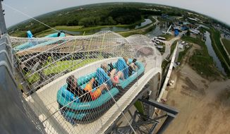 "FILE - In this July 9, 2014, file photo, riders go down the water slide called ""Verruckt"" at Schlitterbahn Waterpark in Kansas City, Kan. A state inspection has found 11 alleged violations of regulations at the Kansas water park where a 10-year-old boy died in 2016. The Kansas Department of Labor made an audit of the Schlitterbahn park in Kansas City public Tuesday, May 22, 2018, a day after issuing a notice to the park. The audit said safety signs in some park areas were not adequate, records were not available for review and some operating and training manuals were not complete. (AP Photo/Charlie Riedel, File)"