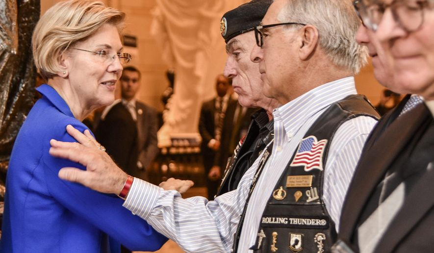 Sen. Elizabeth Warren, Massachusetts Democrat, who was instrumental in placing the POW/MIA Chair of Honor in the U.S. Capitol in November, greets Rolling Thunder, Inc. Founder and Executive Director Artie Muller (center, in beret) and Legislative Director Gus Dante. (Photo by Patrick J. Hughes, Rolling Thunder Inc. National Photographer www.patrickjhughes.org.)