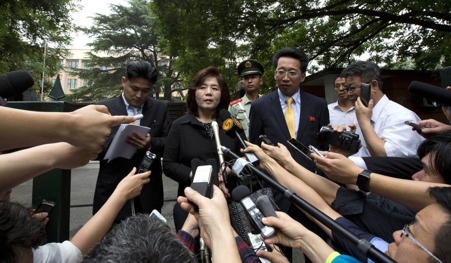 Choe Son Hui, deputy director general of the Department of U.S. Affairs of North Korean Foreign Ministry, briefs journalists outside the North Korean embassy in Beijing Thursday, June 23, 2016. Choe is in Beijing to attend the Northeast Asia Cooperation Dialogue and said North Korea is confident of coping with nuclear war. (AP Photo/Andy Wong)