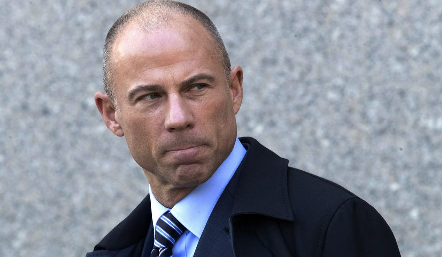 """FILE - In this April 26, 2018 file photo, Michael Avenatti, attorney for Stormy Daniels, who alleges she had an affair with President Donald Trump, leaves federal court in New York after a hearing for Michael Cohen, Trump's personal attorney. Avenatti, said Monday, May 14, he did nothing wrong by distributing a report last week that detailed the finances of Cohen and showed he had charged companies a hefty price for """"insight"""" about Trump. (AP Photo/Mary Altaffer, File)"""