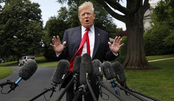 "President Donald Trump's hair is ruffled by a breeze as he speaks to the media on the South Lawn of the White House in Washington, Wednesday, May 23, 2018, en route to a day trip to New York.  Trump will hold a roundtable discussion on Long Island on illegal immigration and gang violence that the White House is calling a ""national call to action for legislative policy changes.""   (AP Photo/Jacquelyn Martin)"